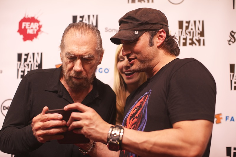 Robert Rodriguez (r) showing off a picture he took on the red carpet for his film Machete Kills.